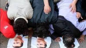 Syrian people bowing down in prostration to their Syrian President